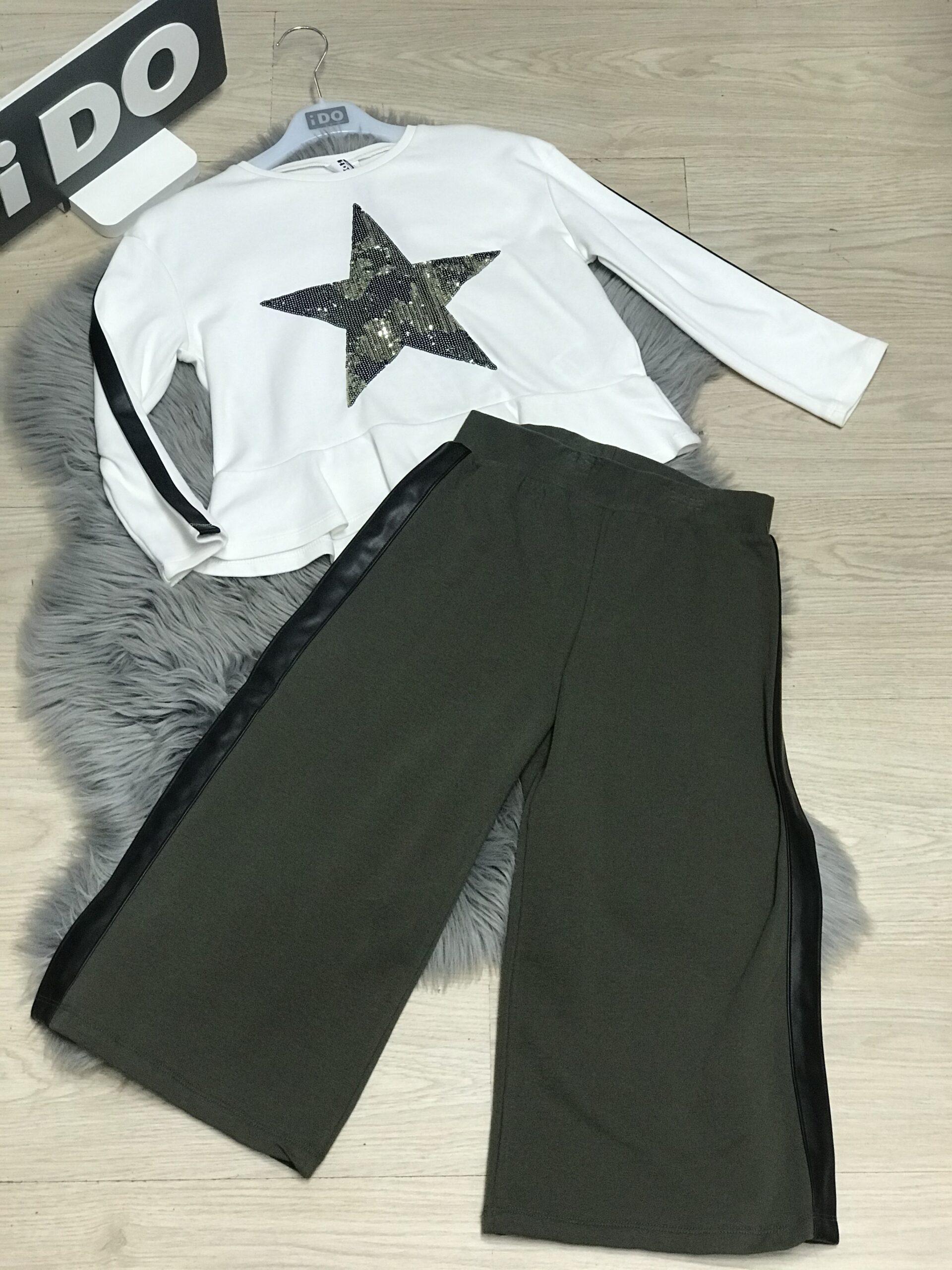 csillagos fehér felső zöld bőszárú nadrággal
